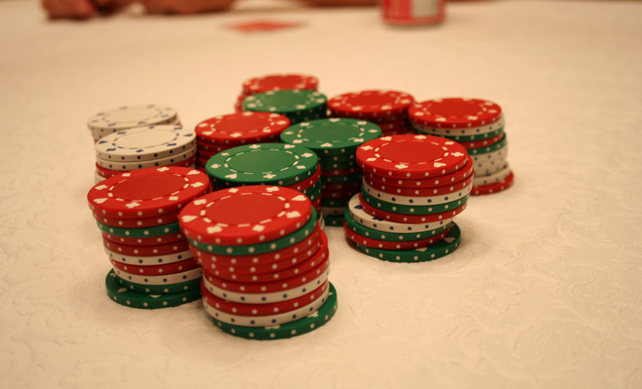 Poker chips red green white stacked even