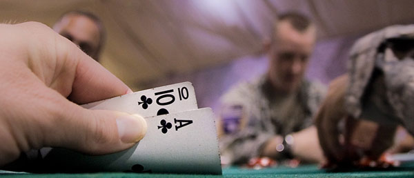 Poker hand Ace Ten suited of Clubs