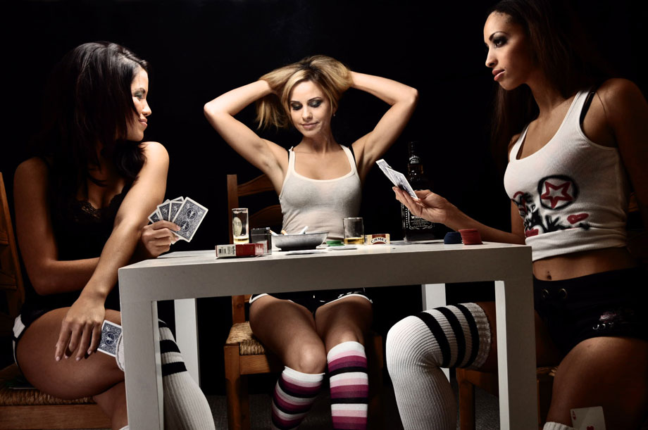 3 sexy girls playing poker
